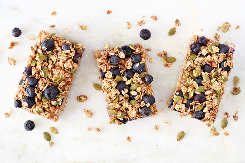 Three healthy granola flapjacks in a row.