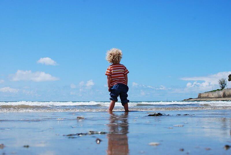 Boy enjoying great beaches and coastline in Dorset