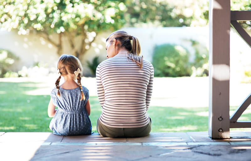 Parent and child resolving family conflict