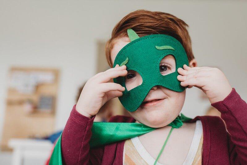 kid in hero mask