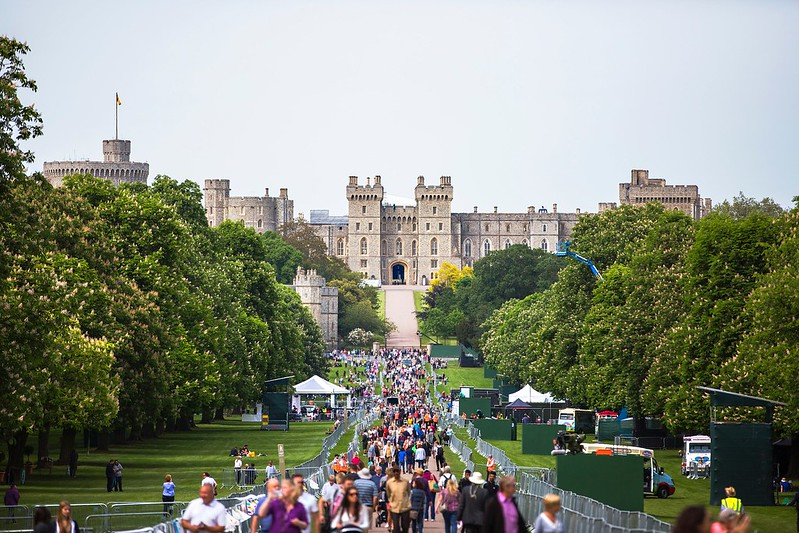 Crowds milling about on the long path leading up to Windsor Castle.