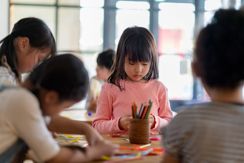 child at art class in London