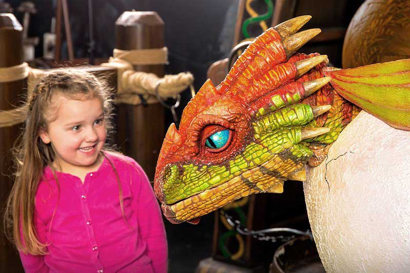 child with dragon at shrek's adventure