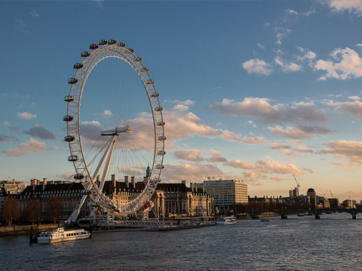View of the London Eye at sunset from Hungerford Bridge.