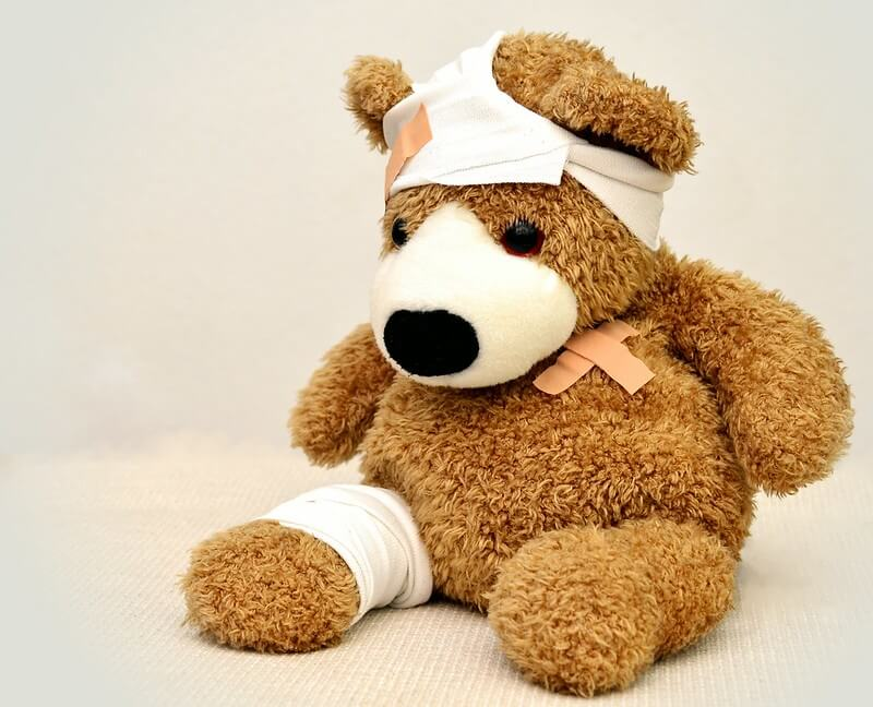Bandaged bear demonstrating baby first aid equipment for the baby first aid checklist.