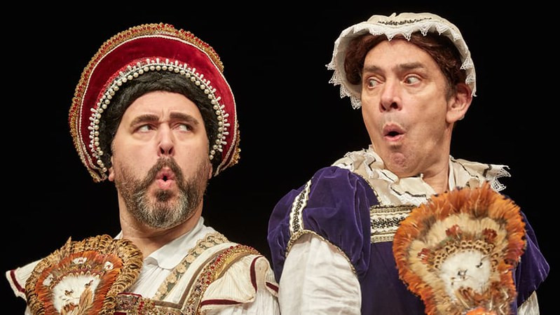 Horrible Histories actors live on stage.