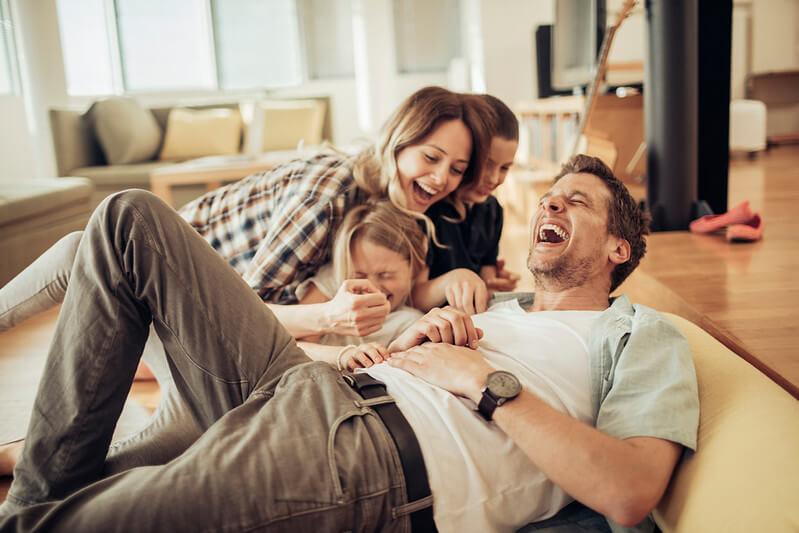 Family laughing at car puns