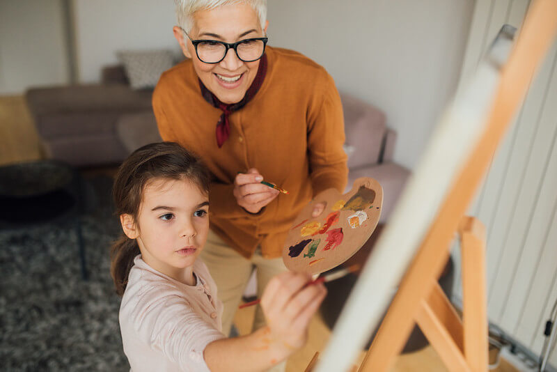 Grandmother helping child make famous art copy for kids project