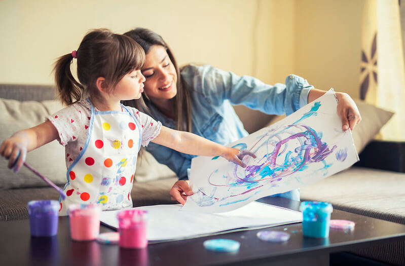 mother helping young child to make a famous art copy kids project