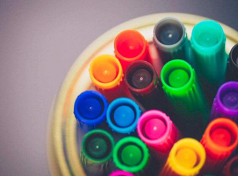 Coloured markers for colouring pages