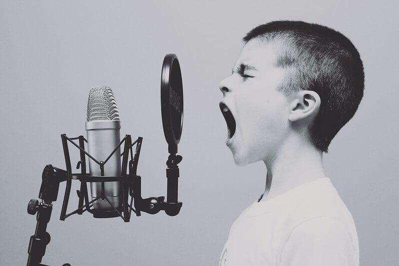 kid singing at home