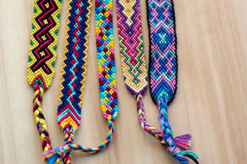 Easy weaving and braiding activities for kids and teens, such as friendship bracelets shown here