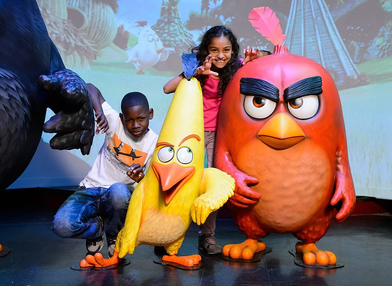 Boy and girl posing with two Angry Birds characters at Madame Tussuds.
