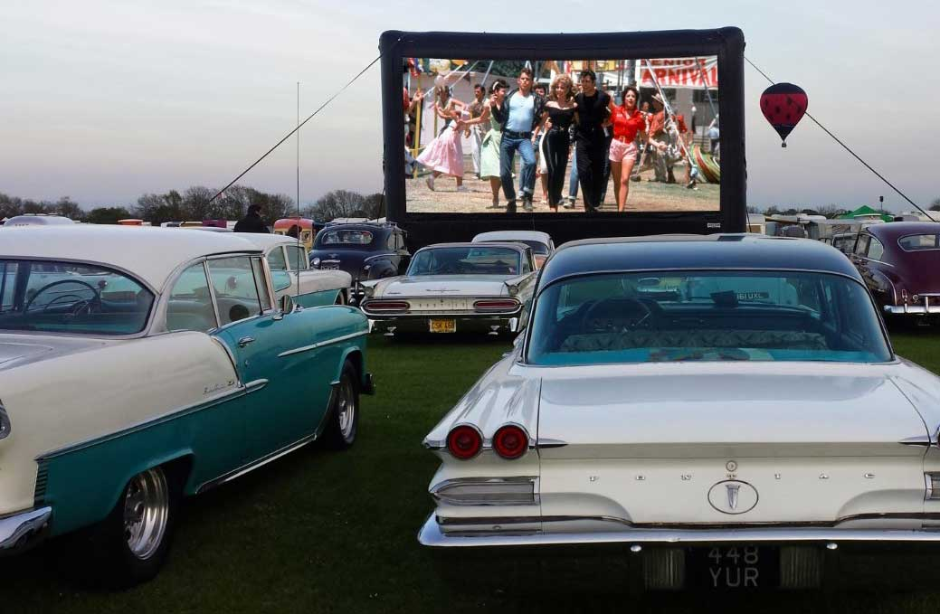 grease showing at a drive-in cinema
