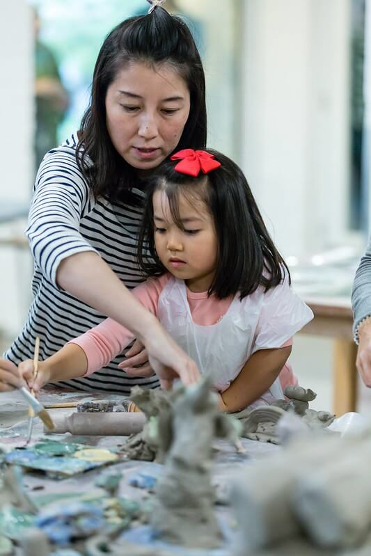 Mum and daughter making history craft learning activities