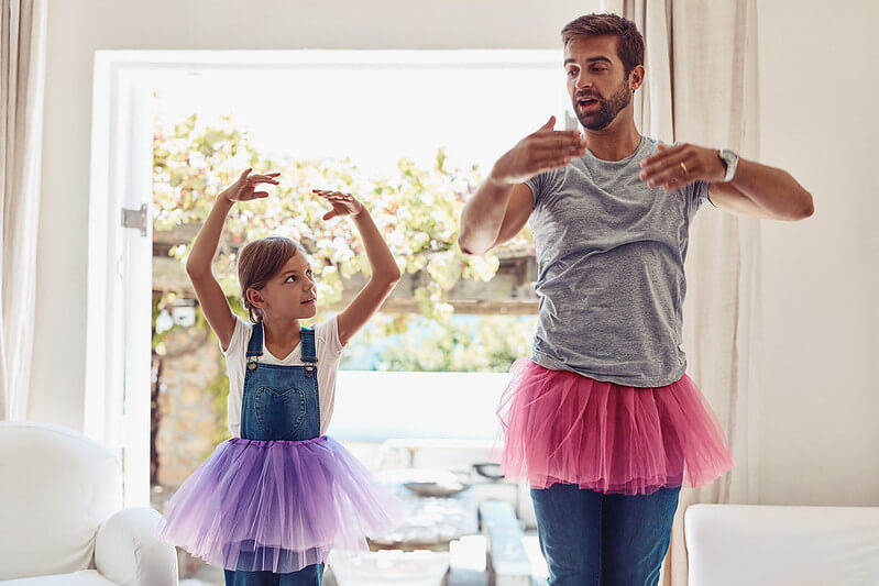 Father coaching daughter in ballet for kids at home