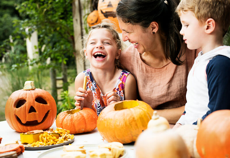 Family laughing at Halloween holiday jokes