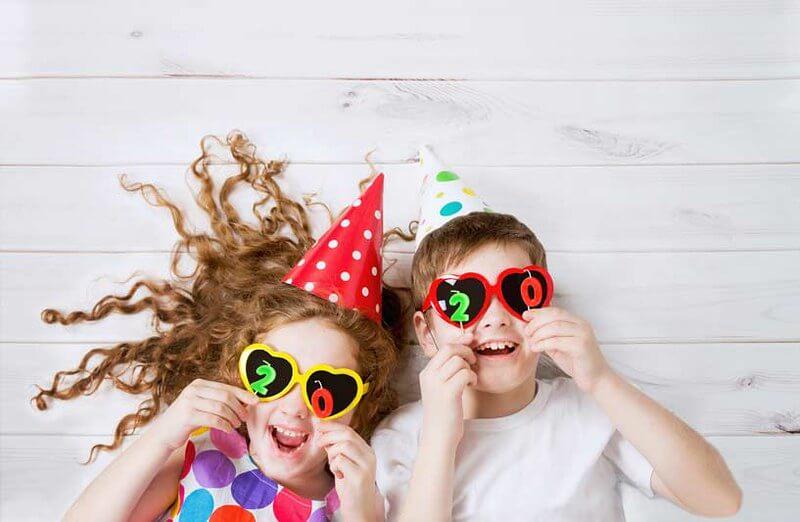 Kids laughing at new year holiday jokes