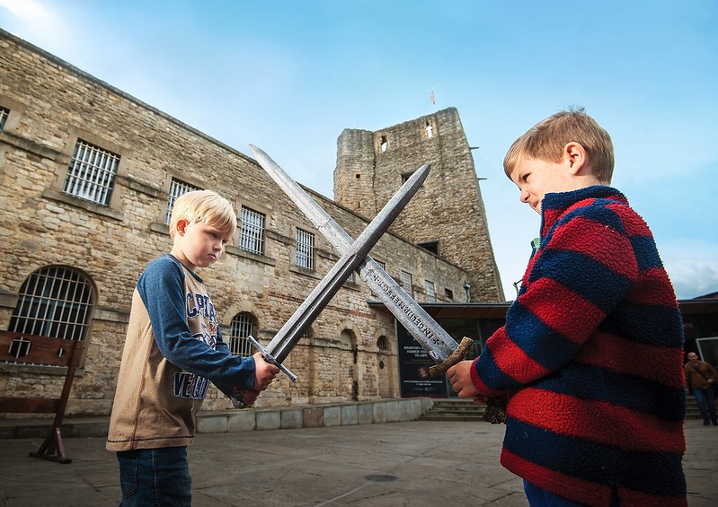 Two young children enjoying knight training at Oxford Castle.