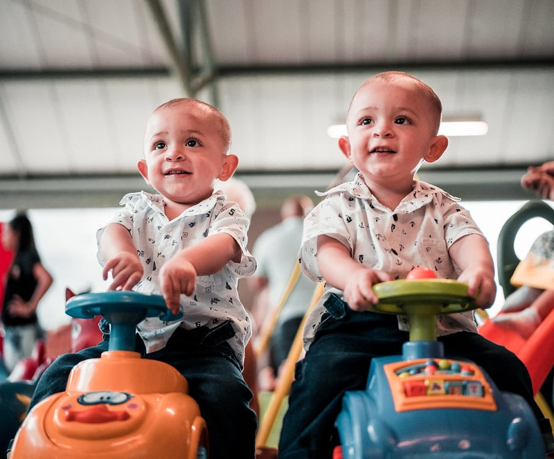 Idal and Iden, two brilliant boys' names beginning with I, are great names for these twins sitting on toy cars.