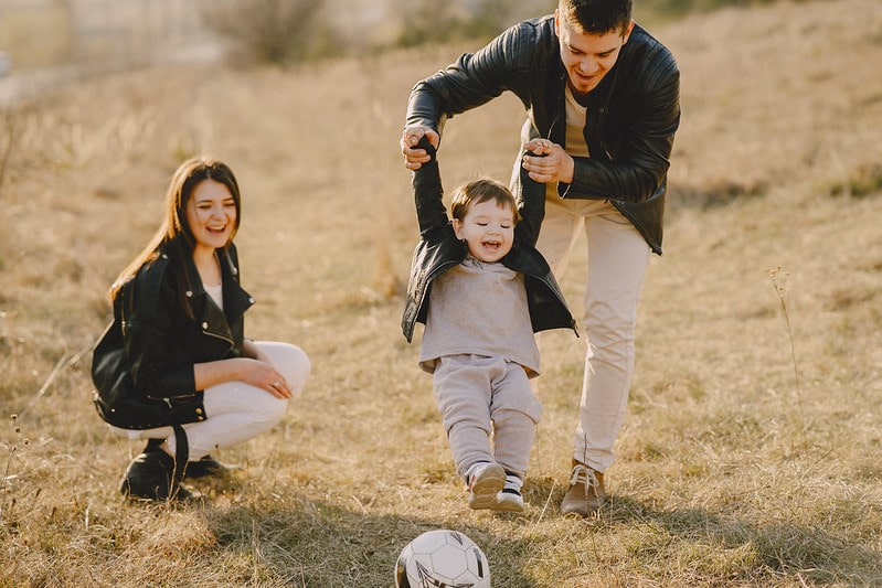 Family, with a son whose name is beginning with F, play football together