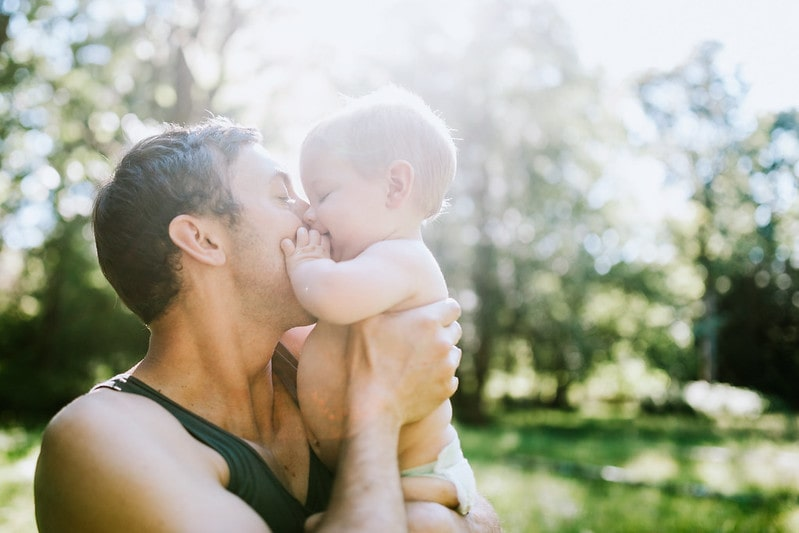 Dad kisses son who has a name beginning with W.