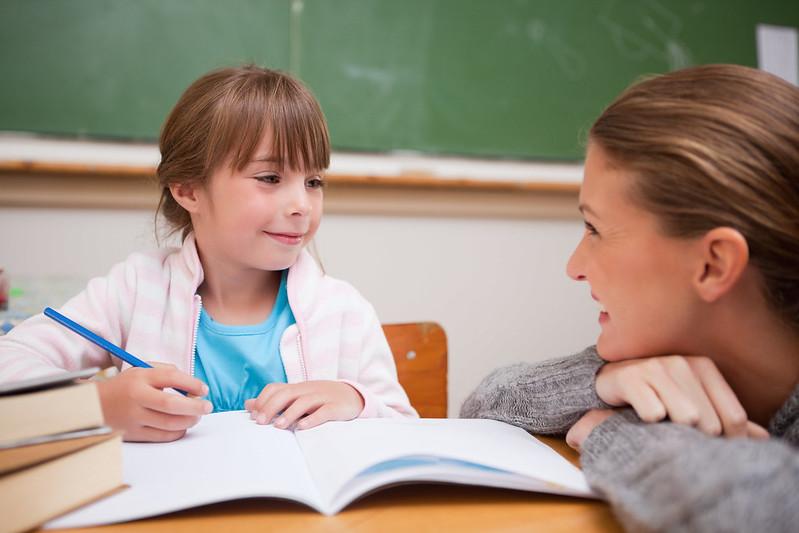 Year 2 girl being tutored in Year 2 spelling words.