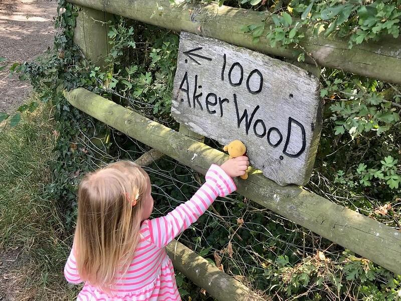 kid at 100 Aker Wood sign in Aldenham Country Park