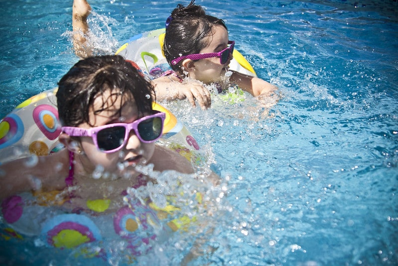 Keep a paddling pool clean so your kids can swim around like these two little girls in their inflatables.