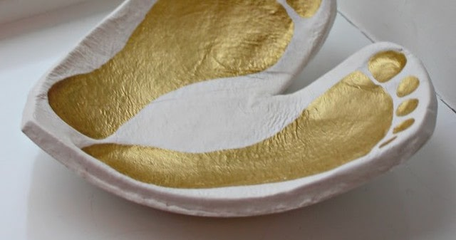 Close up of a baby foot print ornament heart-shaped bowl.