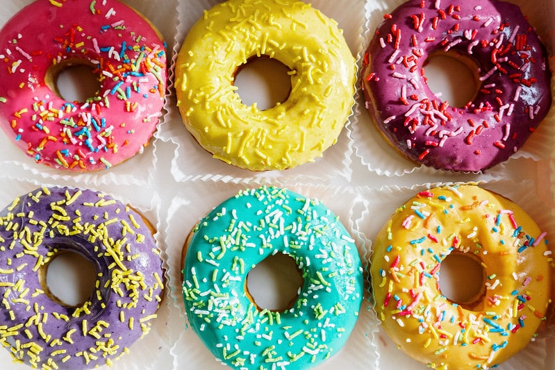 Tell people you're pregnant with colourful doughnuts.
