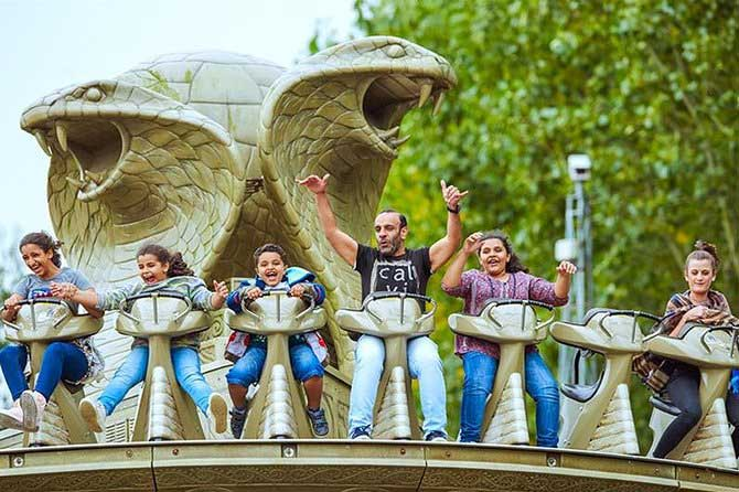 Family on ride at Chessington World of Adventures.