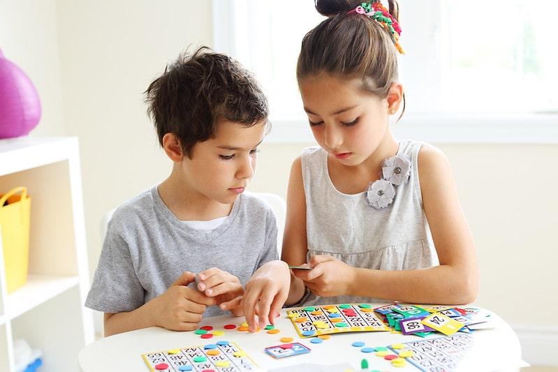 Siblings working out grid method multiplication