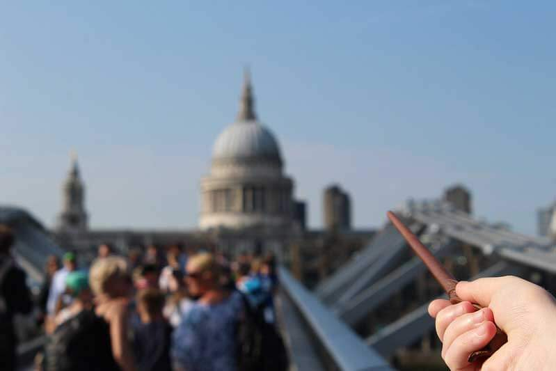 hand pointing a wand towards st paul's cathedral