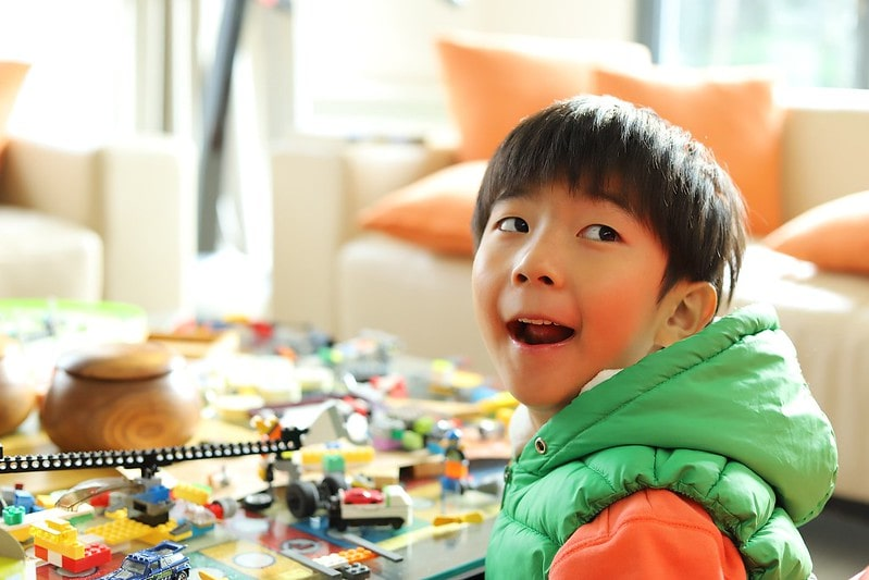 Young boy enjoying lego before making his own awesome lego candy dispenser.
