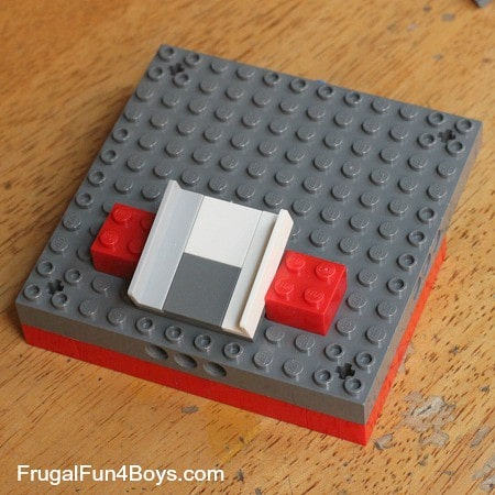 A demonstration of the ramp positioning for a lego candy dispenser
