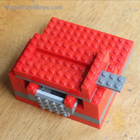 Check the sliding arm of your lego candy dispenser.