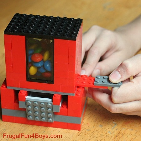 Demonstrating the dispensing action of the lego candy dispensers