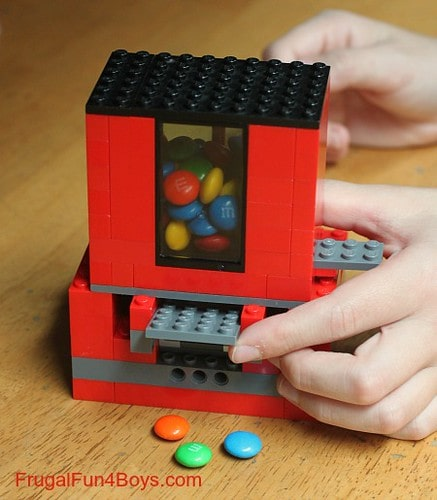 Sweets coming out of the lego candy dispenser