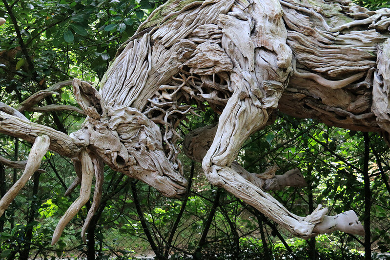 sculpture of a horse carved from wood
