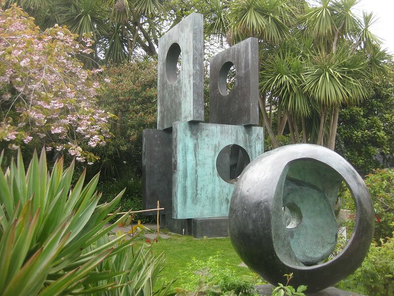 stone Barbara Hepworth sculptures in a garden