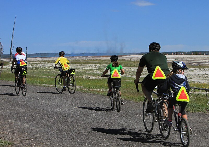 family cycling along coastal path