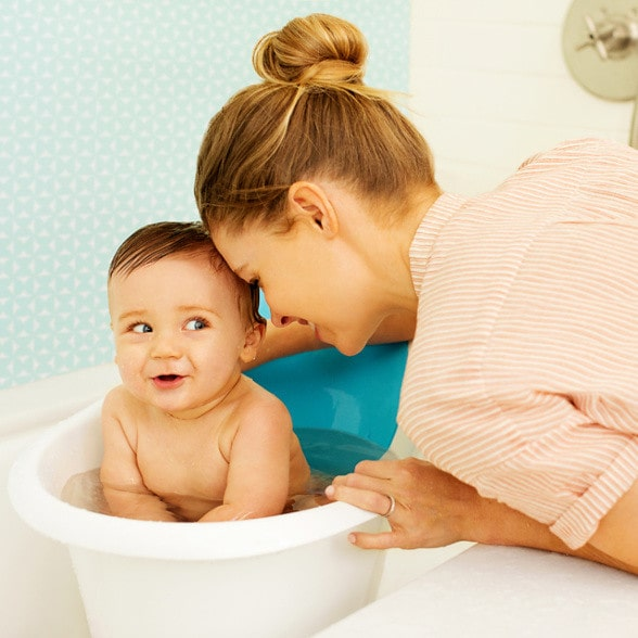 Baby in baby bath with support