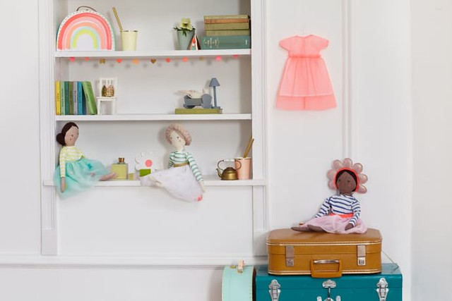 Meri Meri dolls, an example of diverse toys, sitting around in a young child's bedroom.