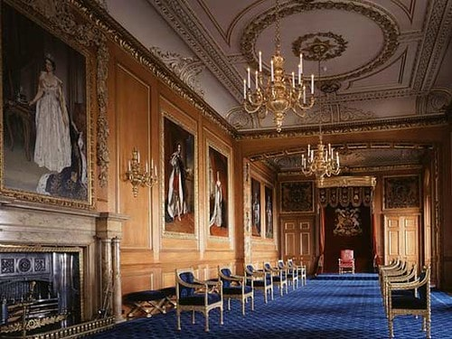 Windsor Castle interior showing portraits on the walls.