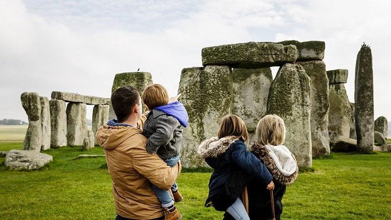 A family enjoying the view of Stonehenge.
