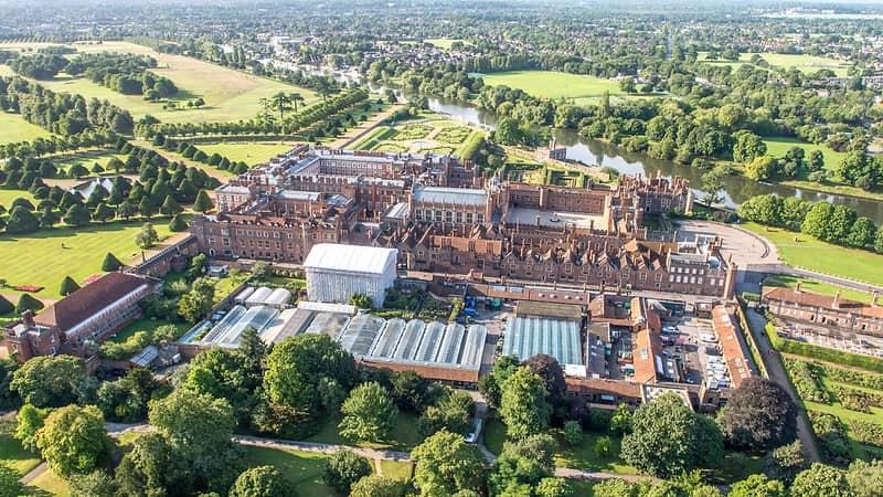 High angle shot of Hampton Court Palace and its surrounding grounds.