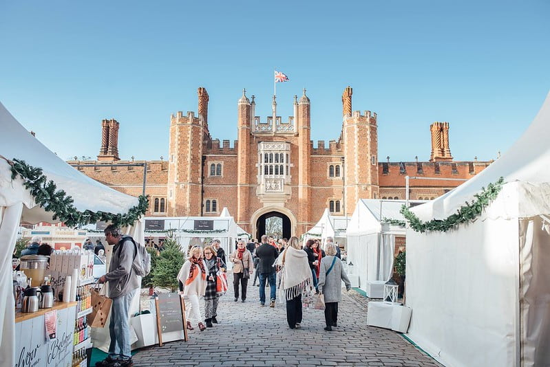 People visiting Hampton Court food market.