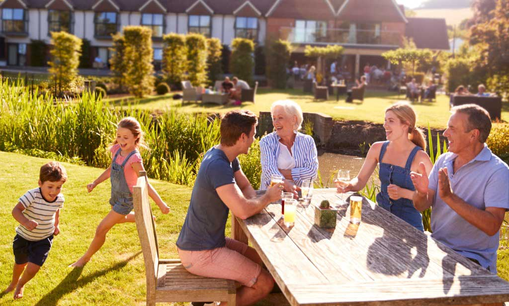 Family enjoying outdoors at child-friendly pub.