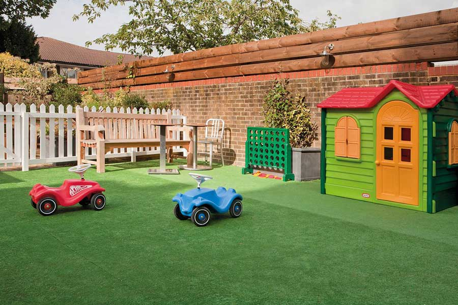 Outdoor playhouse and games for kids at The Rosendale pub.